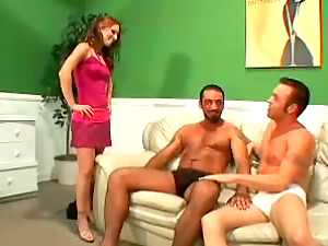 Bisexual Threesome Featuring Two Guys and a Woman with a Strapon