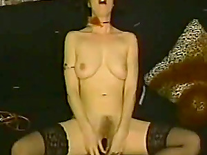 Dark-haired Cougar Is Alone On The Sofa Caressing Her Cunt