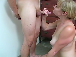 G-string Clad Blonde on Her Knees Providing a Hot Deep throat