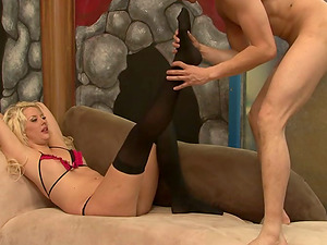 Blonde nymph in undergarments and stockings deep throats a dick