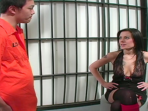 Sexy brown-haired chick gives a handjob to an inmate