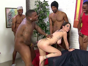 Hot Tattooed Tart Luving In Interracial Group sex With A few Guys