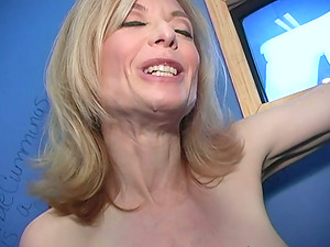 Mature blonde Nina Hartley gargles a Big black cock thru a gloryhole
