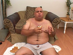 A very fat dude puts a condom on and goes for that beaver