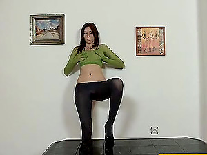 Nylon covered dark-haired Kattie Gold  pounds her snatch with a fucktoy