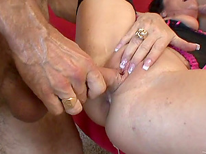 Mature De'bella is fucked by two large hard-ons in a threesome