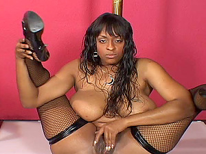 Ebony-skinned porno starlet with enormous tits sucking a big milky manstick