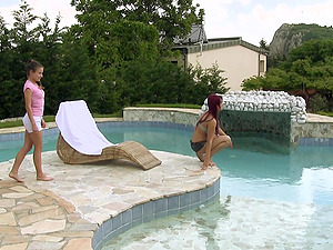 Two divine huge-titted lezzies please each other in the pool