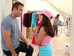 Boy Tempts A Youthful Dark-haired At An Indoor Yardsale