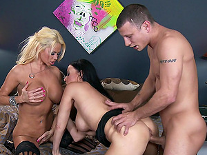Big-boobed ladies share a thick man sausage in a threesome