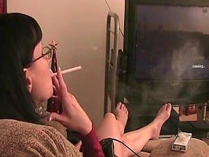 Dark haired In Glasses Smoking Strenuously In A Reality Shoot