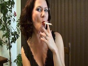 Amazing cougar Mina flashes her cleavage while smoking a ciggie