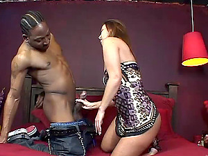 Gorgeous Cougar Fellates Intense Nut sack In An Interracial Hookup