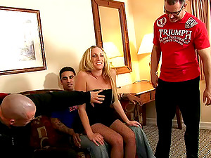Sexy blonde stunner in fishnet likes screwing and sucking dick in group sex