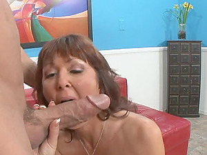 Mature bi-atch with faux tits gets fucked by youthful stud while her man sees