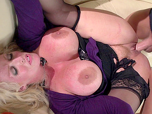 He plays with her massive tits and nips while hammering her