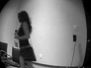 A woman masturbates her cootchie in front of the spy webcam