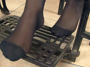 Her stilettos come off so she can work in her stocking covered feet