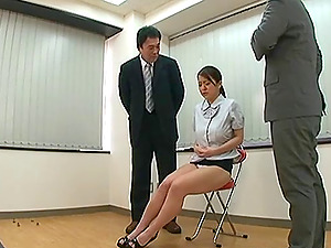 Two businessman fondling the tits of a Japanese honey