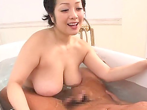Chubby Asian cougar with giant natural tits sucking her bf's penis
