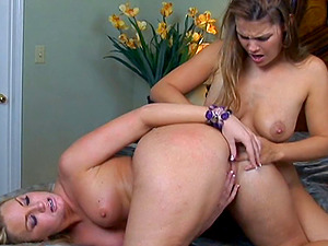 A stacked blonde uses her tongue and fucktoys to sate her gf