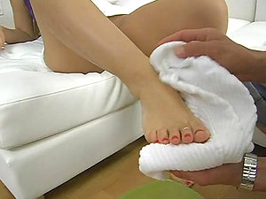 Blonde gets her feet washed before providing a footjob