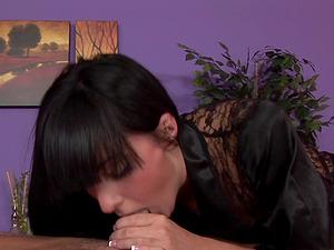 Long legged masseuse in soft black satin gives a fine bj