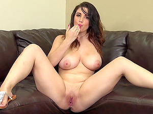 Curvy honey with big knockers finger fucks her snatch