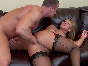 Ava Devine gets nasty with a muscular man that bangs her hard