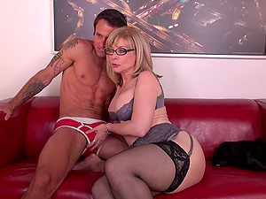 Cougar pornographic star in glasses and underwear fucked in a live showcase