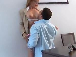 Nerdy office chick has a chance to spread her gams for the pointy dick