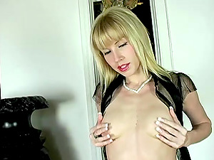 Solo blonde dame in sexy lip liner and high-heeled slippers masturbates