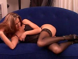 She strips off her undergarments then violates out her fucktoy and plays