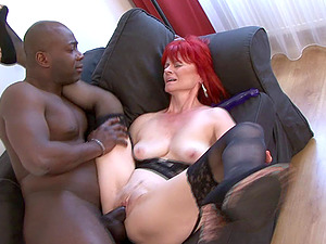 Black manstick nuts in the mouth of a horny old lady