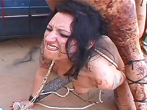 Rough girly-girl female domination have fun outdoors with chocolate sauce mess