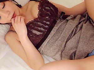 Japanese woman with a sexy smile deep throats his dick passionately