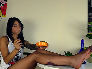 Dark-haired cutie smokes a ciggie and exposes her attractive gams