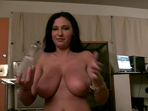 Lengthy hair black-haired with big tits providing massive dick boobjob
