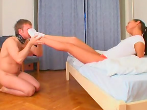 Marionette sucking foot worship socks passionately in female domination pornography