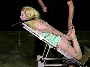 Blonde in restrain bondage yelling when screwed using hump machine in Sadism & masochism