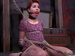 Restrain bondage red-haired victim having her bootie spanked when tantalized