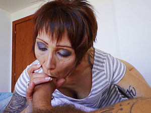 Compelling Cougar with a tattooed figure bouncing on the erected dick