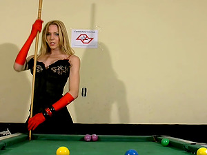 Fabulous blonde shemale strips on a pool table and milks off