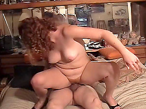 Curly-haired Cherry Poppens shows her goods and gets fucked