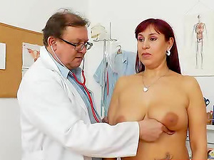 Long-haired mature redhead comes to her doctor and gets fucked