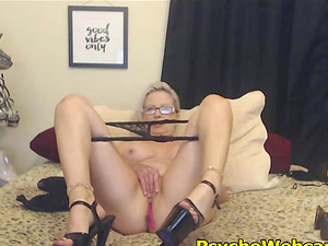 Blond mom with short hair rolling in her bed with a toy in her pussy