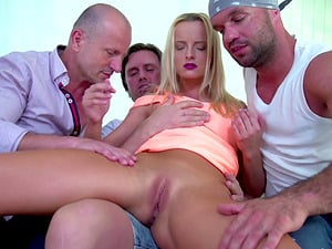 Victoria Pure seduces a bunch of men for a gangbang session