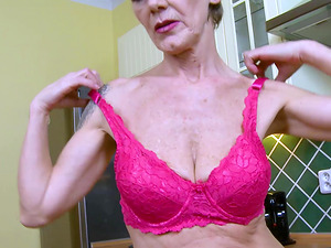 Horny slim mature granny is playing with her hairy natural pussy
