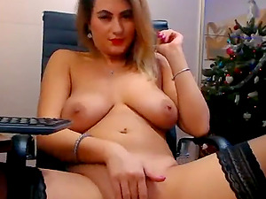 Girl has wide opened legs and masturbates while having a vibrator in the pussy.