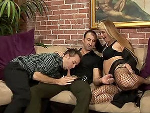 Big-titted blonde Joclyn Stone fucks two guys with a strap on